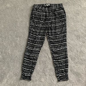 Black VANS joggers with white stripes
